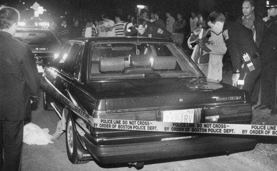 Police investigate Charles Stuart's car at the shooting scene.