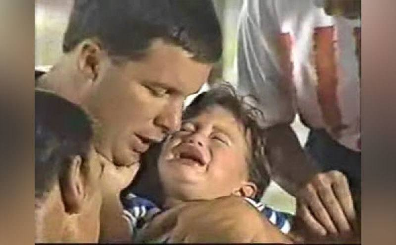 Kyle Bennett cries and screams in his father's arms after the snake bite.